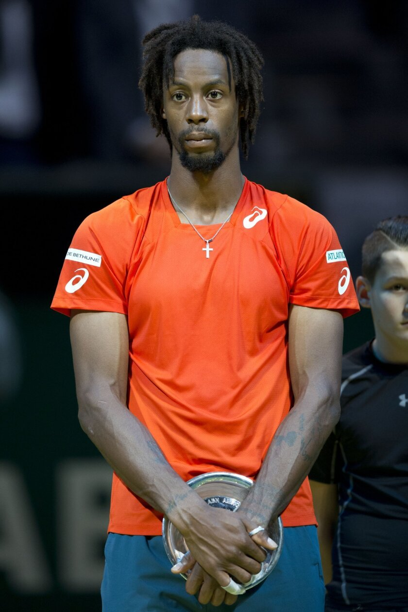 France's Gael Monfils holds the runner-up trophy after losing against Slovakia's Martin Klizan during the final of the ABN AMRO world tennis tournament at the Ahoy arena in Rotterdam, Netherlands, Sunday, Feb. 14, 2016. (AP Photo/Peter Dejong)