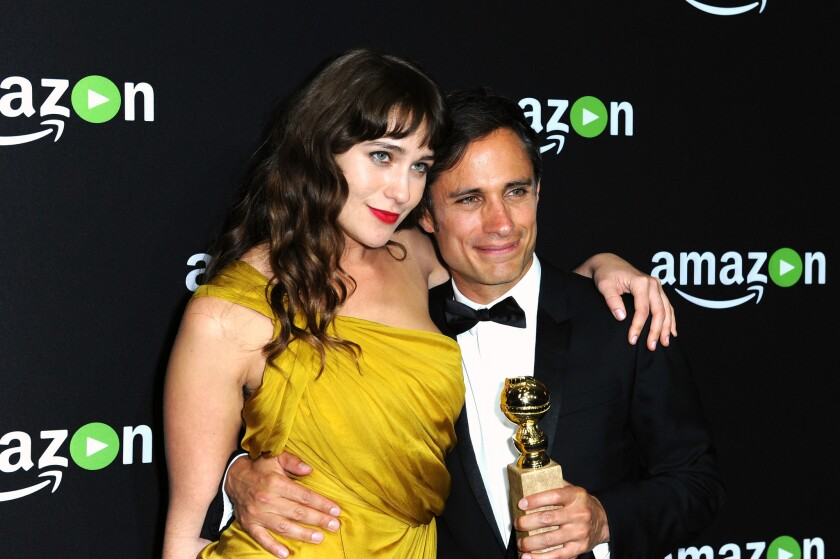 """""""Mozart in the Jungle"""" actors Lola Kirke, left, and Gael Garcia Bernal attend Amazon Studios' Golden Globe Awards party at the Beverly Hilton Hotel on Sunday. The show won the Golden Globe for best TV series, musical or comedy and Bernal won the Golden Globe for best actor in a TV series, musical or comedy."""