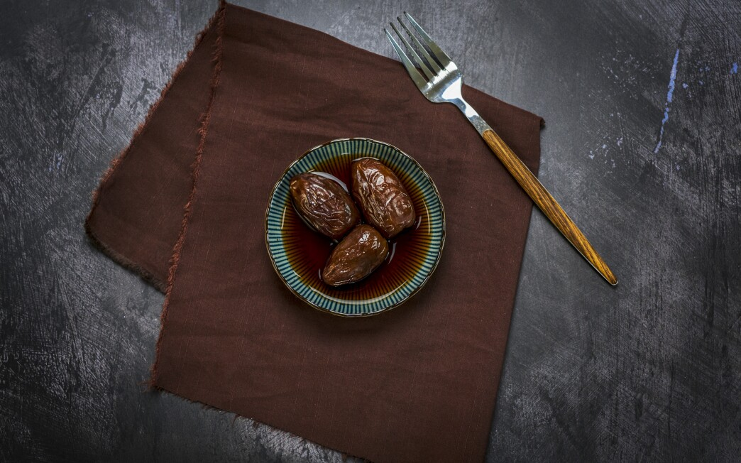 Leftover coffee adds pleasant bitterness and caffeine to large, sweet dates for a pick-me-up snack.