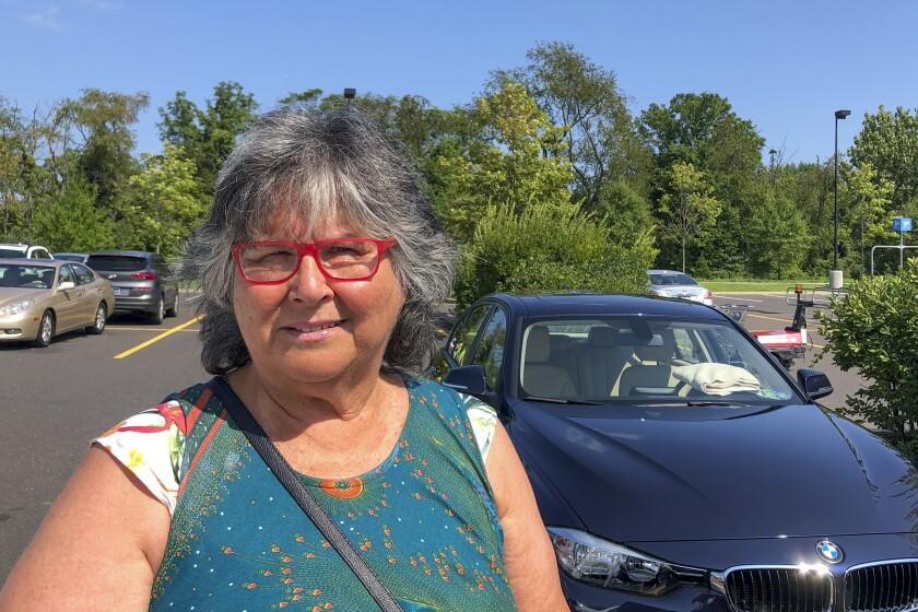 Susan Giffen stands in a parking lot