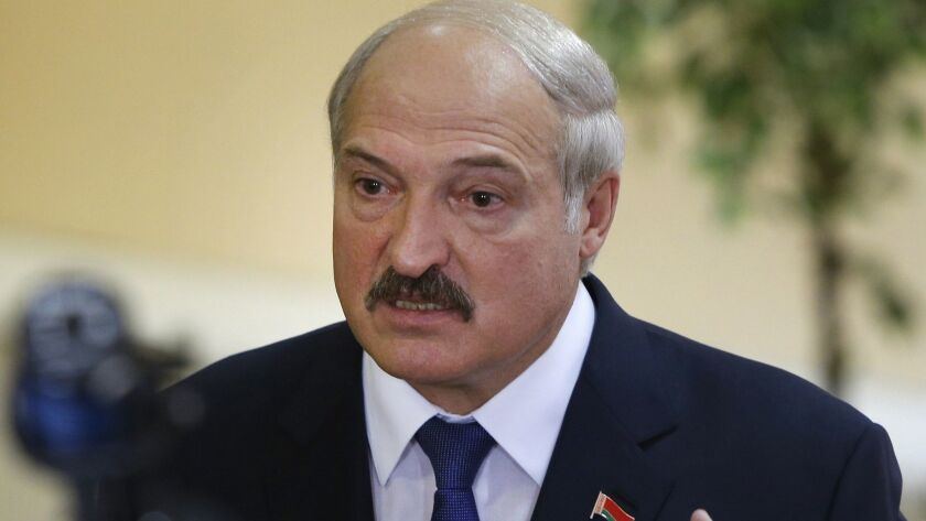 Belarusian President Alexander Lukashenko speaks at a polling station after voting during the 2015 presidential election in Minsk.