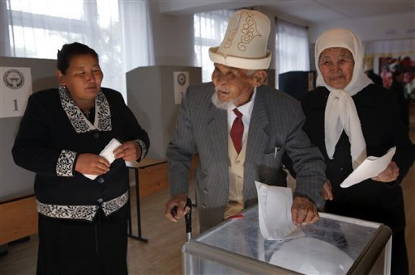 Kyrgyz people cast their ballots at a polling station in the village of Arashan, 20 km. (12 miles) south of the capital Bishkek, Kyrgyzstan, Sunday, Oct. 10, 2010. Voters turned out in force Sunday in Kyrgyzstan for parliamentary elections to choose a new parliament in the hope that it will usher in a new era of democracy, in sharp contrast to the strongman model exercised under President Kurmanbek Bakiyev, who was ousted from power in April 2010 amid violent public demonstrations. A U.S. air base is hosted in Kyrgyzstan which is seen as strategically vital to the conflict in Afghanistan. (AP Photo/Alexander Zemlianichenko)