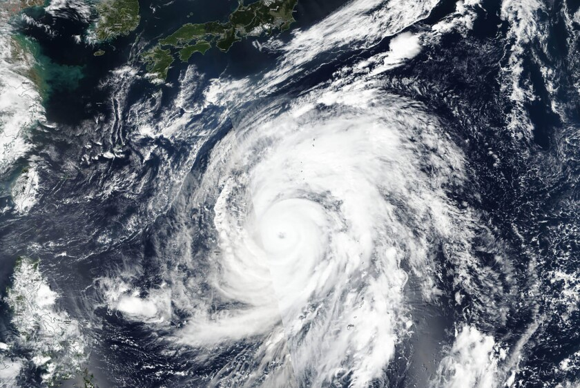 A satellite photo taken Wednesday by NASA-NOAA's Suomi NPP satellite shows Typhoon Hagibis approaching Japan. Japan's weather agency is warning the powerful typhoon may bring torrential rains to central Japan over the weekend.