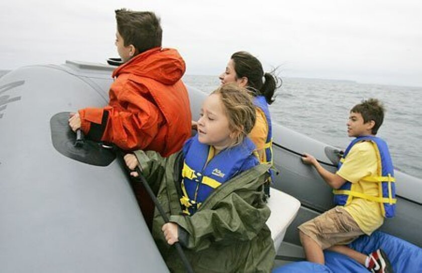 Adam Skirvin (left), 10; Hayley Cavazos, 6; Lucy Skirvin (back) and Alec Skirvin, 13, went whale watching yesterday on Adventure R.I.B. Rides. (Eduardo Contreras / Union-Tribune)