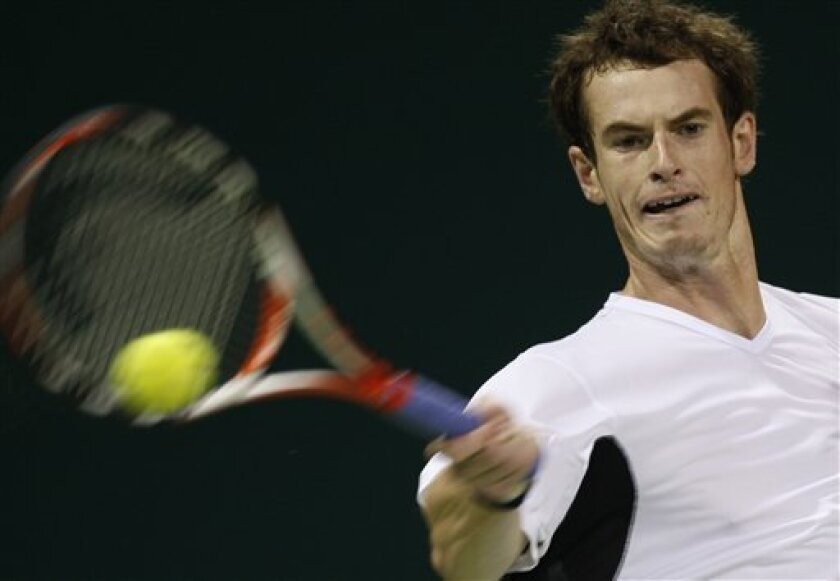Britain's Andy Murray returns the ball to Switzerland's Roger Federer during their semifinal match at the ATP Qatar tennis open in Doha, Qatar, Friday, Jan. 9, 2009. (AP Photo/Hassan Ammar)