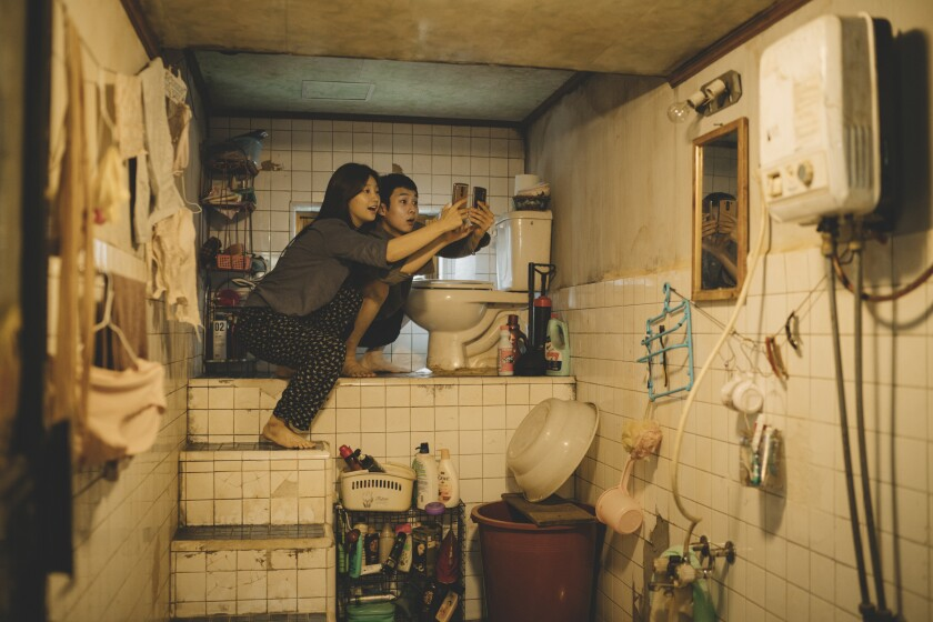 """Park So Dam and Choi Woo Shik in the infamous bathroom from """"Parasite"""""""