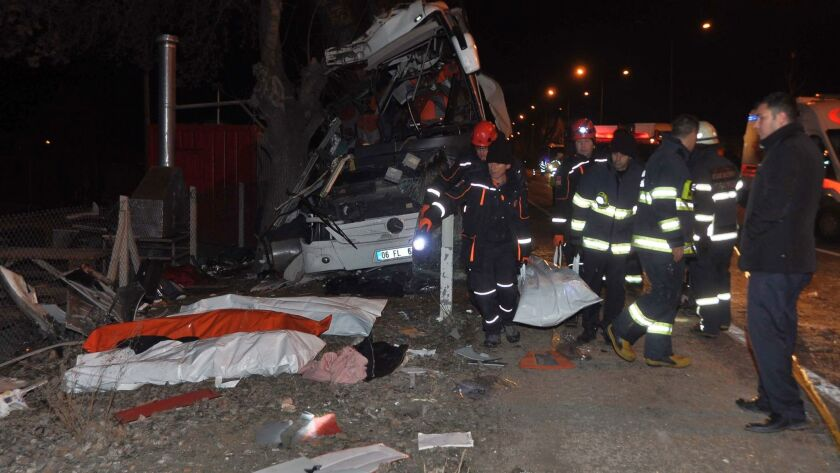 Crews work the scene after a bus crashed into trees in Eskisehir province, Turkey.
