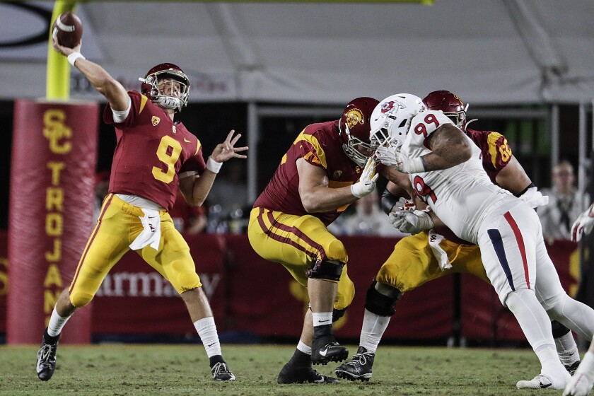 USC quarterback Kedon Slovis launches a pass against Fresno State on Aug. 31 at the Coliseum.