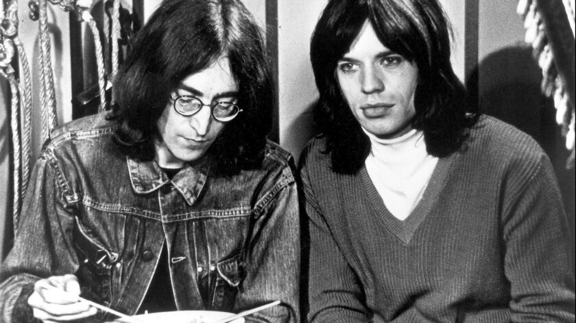 "John Lennon and Mick Jagger in ""The Rolling Stones Rock and Roll Circus."""