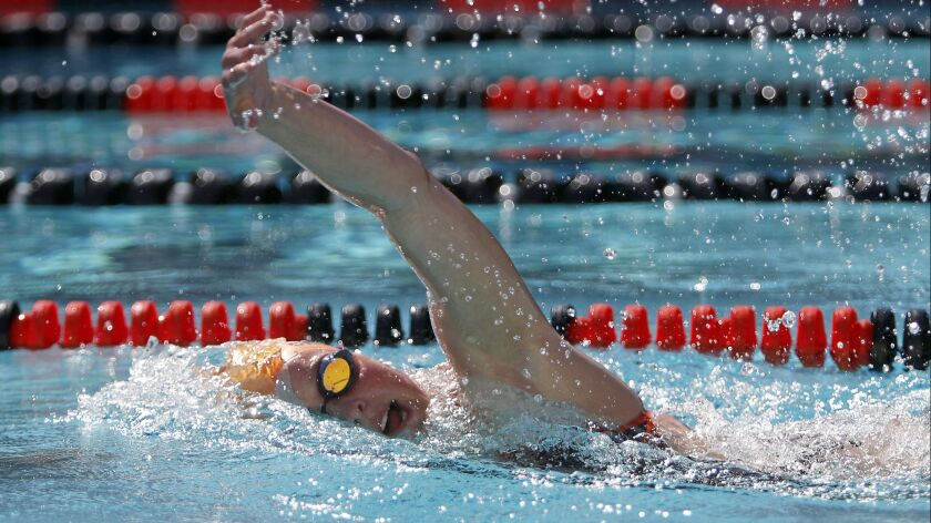 Huntington Beach High senior Natalie Crocker, shown competing in a meet on March 27, 2018, helped the Oilers break the 400-yard freestyle relay school record during Tuesday's meet at Fountain Valley.