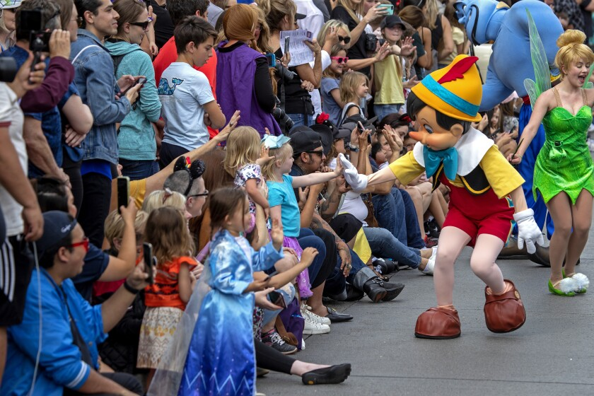 Pinocchio and Tinker Bell greet Disneyland guests
