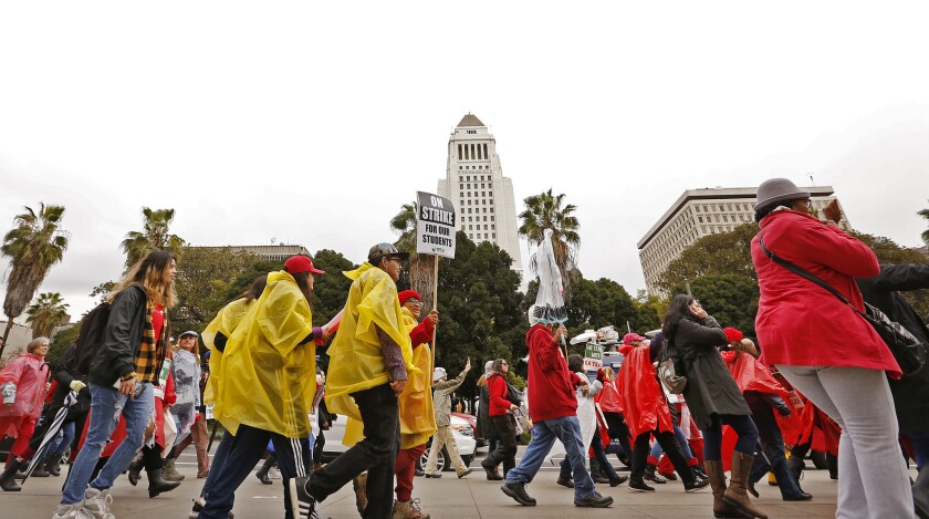 Teachers and supporters make their way through downtown Los Angeles on the second day of the teachers' strike on Jan. 15.