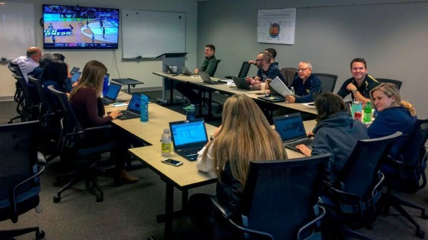 Integrated Project Management, a Burr Ridge consulting firm, seen during last year's NCAA tournament games, has been hosting its own March Madness viewing party for six years.