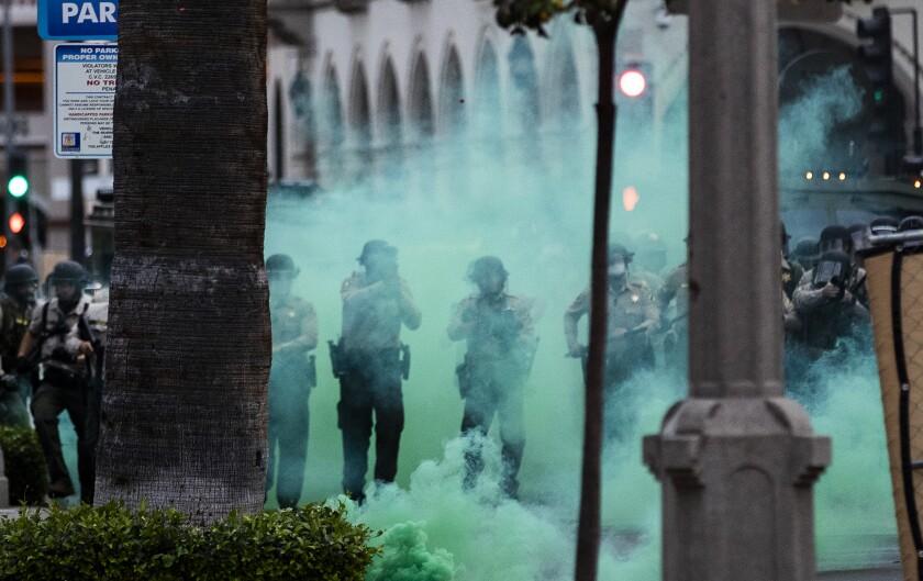 Riverside County sheriff's deputies fire tear gas towards protesters in Riverside.