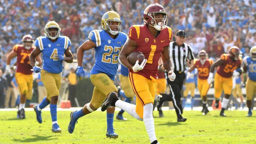 PASADENA, CALIFORNIA OCTOBER 17, 2018-USC receiver Velus Jones Jr. sprints to the end zone for a tou