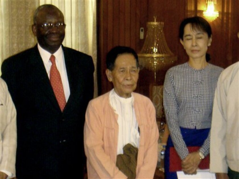 In this handout photo released by Myanmar News Agency, United Nations special envoy to Myanmar, Ibrahim Gambari, left, poses for a group photo with detained Myanmar's opposition leader Aung San Suu Kyi, right, and Chairman of the National League for Democracy party Aung Shwe, center, after their meeting at the government guesthouse in Yangon, Myanmar Monday, Feb. 2, 2009. Suu Kyi expressed frustration to a U.N. envoy Monday over the world body's failure to persuade the country's hard-line military leaders to give up their monopoly on power, her party said. (AP Photo/Myanmar News Agency, HO)