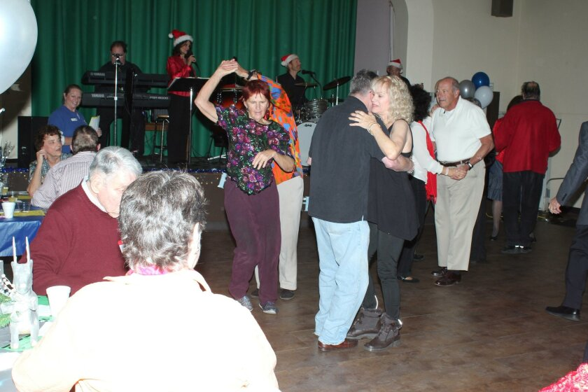 Winter Wonderland ended with 38 registered attendees. Roland Bleu was caught here twirling his wife, Joan, in mid-dance.