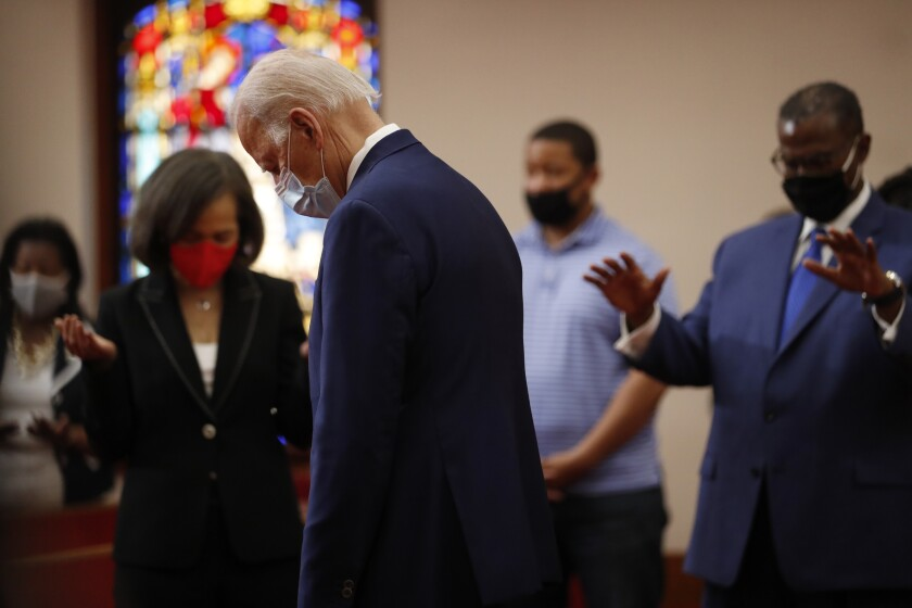 Former Vice President Joe Biden, wearing a mask, bows his head during a June 1 visit to Bethel AME Church in Wilmington, Del.