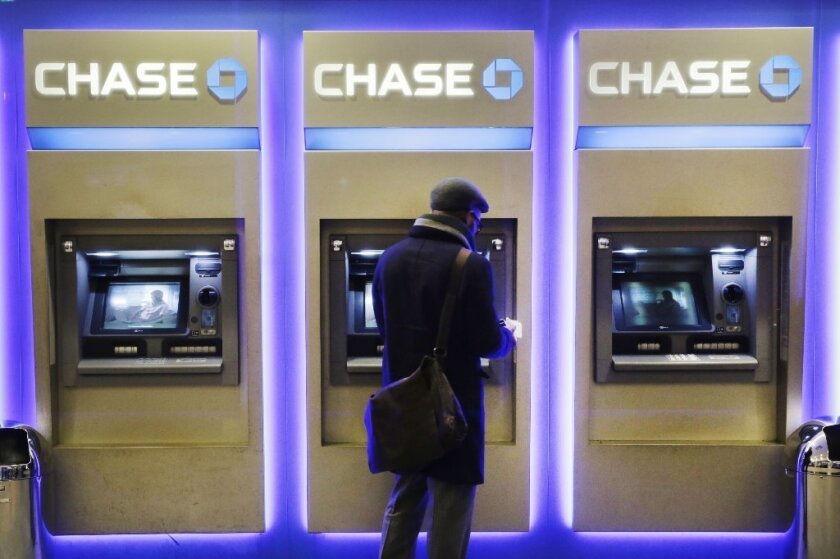 Chase and other banks are increasingly turning to automation for customer transactions. But don't ask them to cut fees because of all the money they're saving.