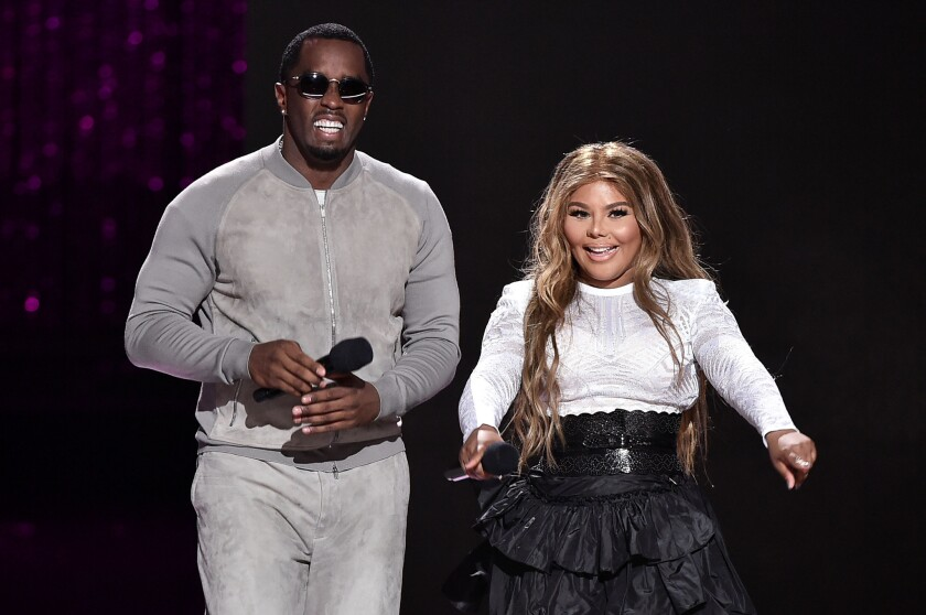 "Sean ""Puff Daddy"" Combs and Lil' Kim, shown performing together in July in New York, will start their Bad Boy Family Reunion Tour a week later than scheduled while Combs continues to recover from recent shoulder surgery."