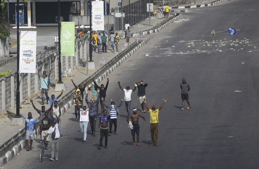 People demonstrate on the street to protest against police brutality in Lagos, Nigeria, Wednesday Oct. 21, 2020.