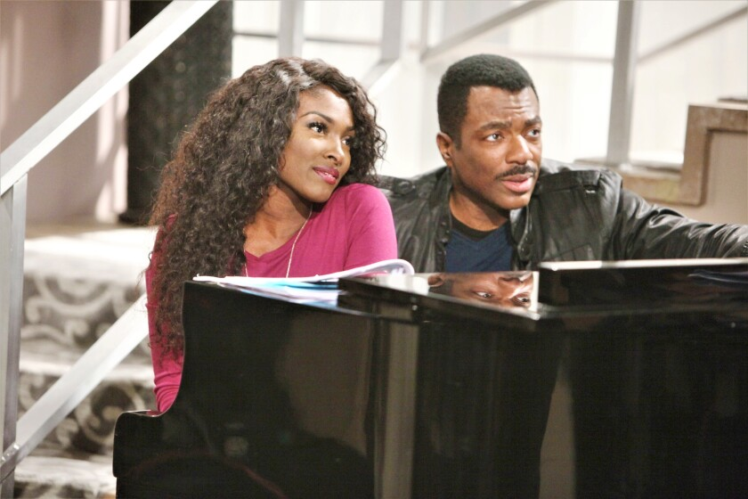 Loren Lott, playing Ana Hamilton, connects with her father, Jett Slade, portrayed by Gilbert Glenn Brown.