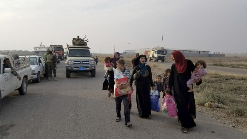 Soldiers separated women and children from men fleeing the village of Tob Zawa after they were freed from Islamic State. Women and children were sent to a displaced persons camp while men and youth were held for further screening.