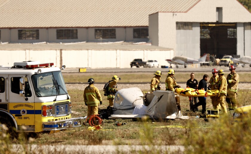 Ventura County Firefighters extricate one of 2 fatal victims of a single engine aircraft that crashed approx 1:30pm at Camarillo Airport. FAA & NTSB are onscene to conduct an investigation.