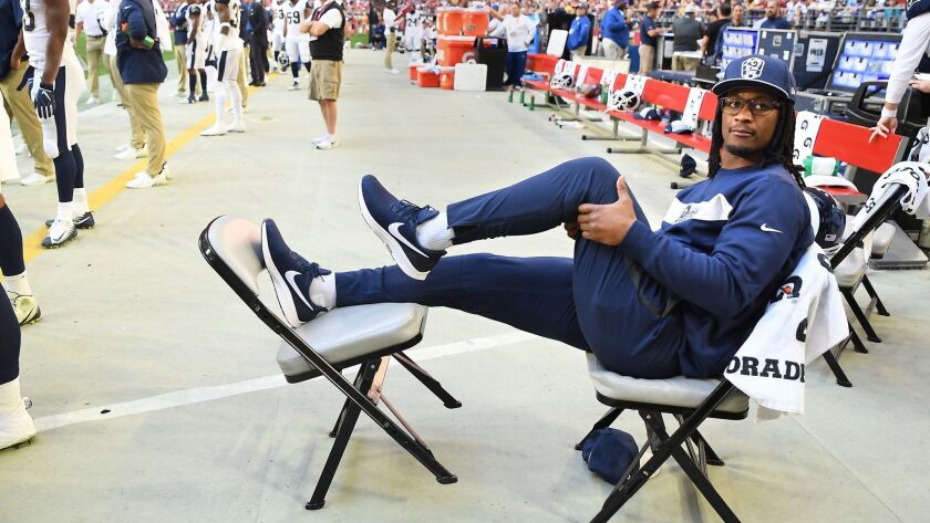 PHOENIX, ARIZONA DECEMBER 23, 2018-Rams running back Todd Gurley messages his knee on the sideline a