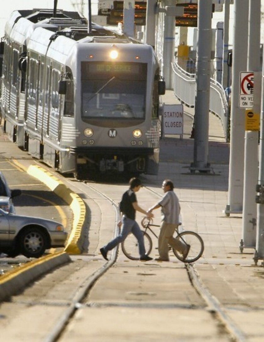A Gold Line train makes its way along 3rd Street. A downtown subway link and a Westside subway extension are among the projects that would be funded through Measure J.