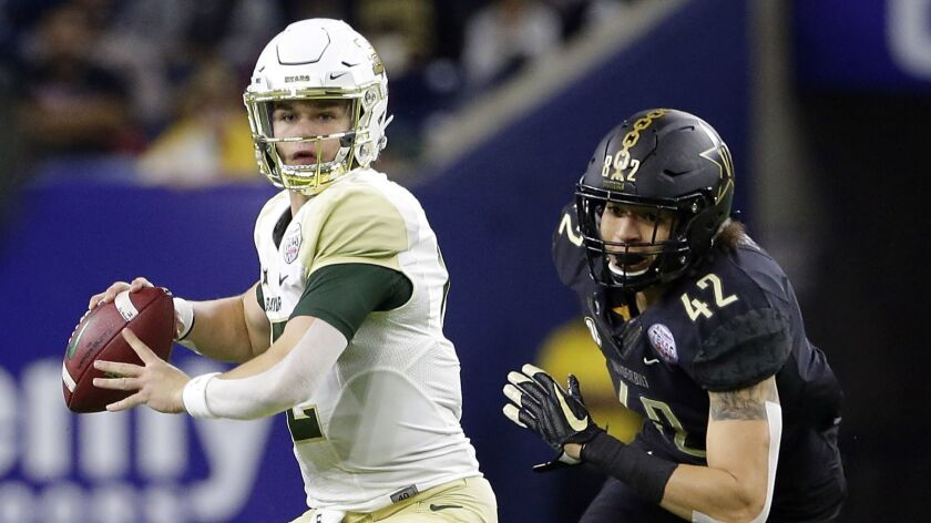 Baylor quarterback Charlie Brewer (12) looks to pass the ball as Vanderbilt linebacker Kenny Hebert (42) closes in during the first half.