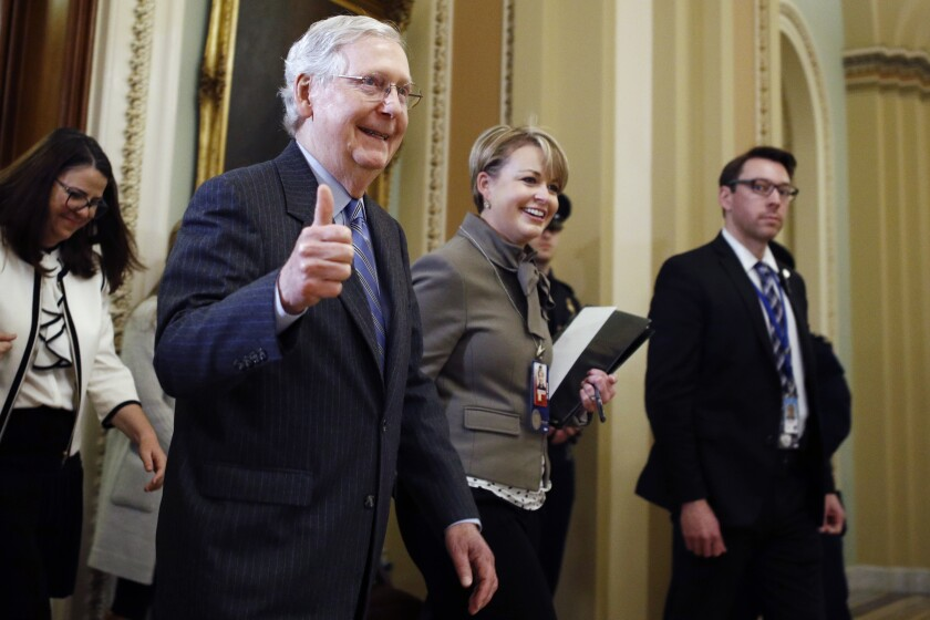 Senate Majority Leader Mitch McConnell, R-Ky., gives a thumbs-up as he leaves the Senate chamber during the impeachment trial of President Donald Trump at the Capitol, Friday, Jan. 31, 2020, in Washington.