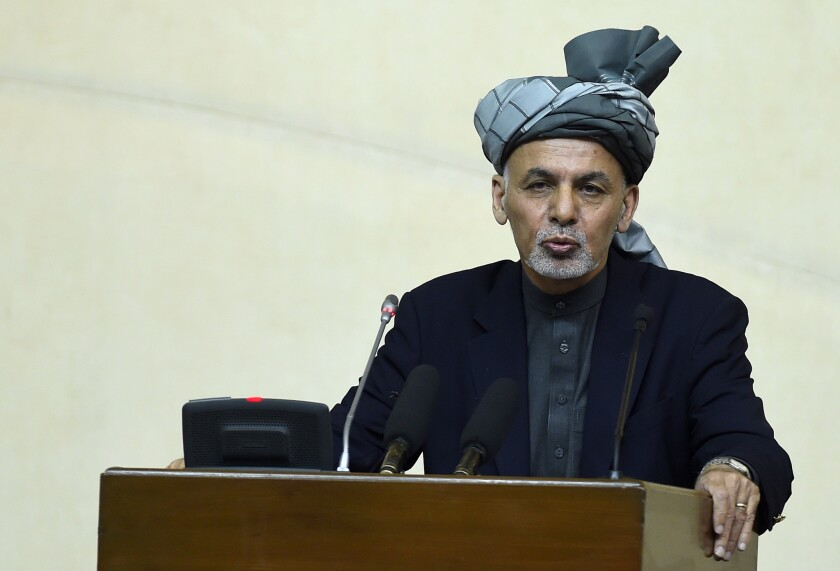 Afghan President Ashraf Ghani speaks to the nation's parliament in Kabul on Monday.
