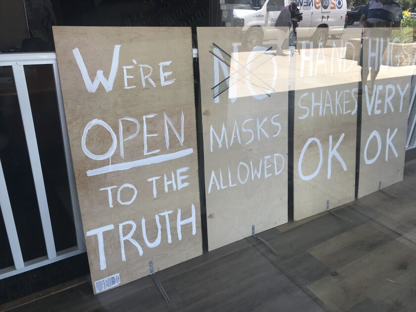 Ramsay Devereux, owner of Ramsay One Construction, a Simi Valley flooring store, caused an online commotion when the anti-social distancing signs he put up two weeks ago were disseminated on social media. He shut the store after receiving threats.
