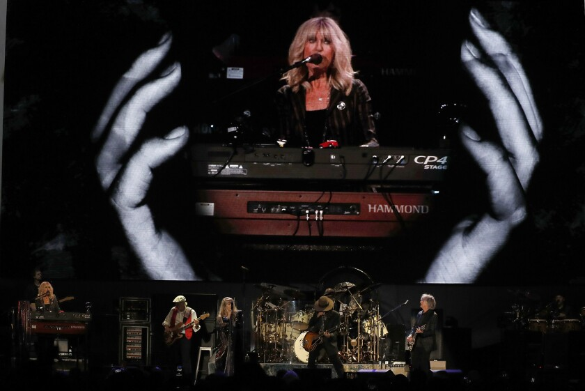 Fleetwood Mac — with Christine McVie, from left, John McVie, Stevie Nicks, Mike Campbell, Mick Fleetwood (on drums) and Neil Finn — performing Tuesday night at the Forum in Inglewood.