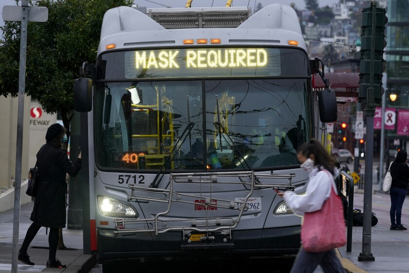 A sign on a Muni bus in San Francisco advises that passengers are required to wear masks.
