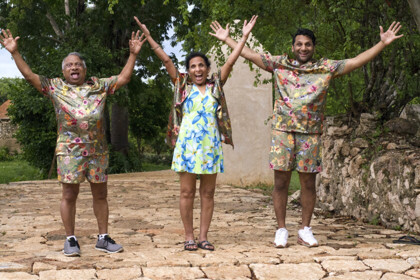Ravi Patel, far right, and his parents Vasant and Champa pose in matching outfits in Mexico.