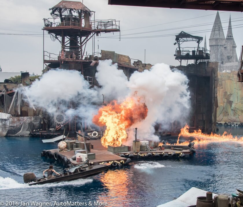"WaterWorld show with ""The Wizarding World of Harry Potter"" in the background"