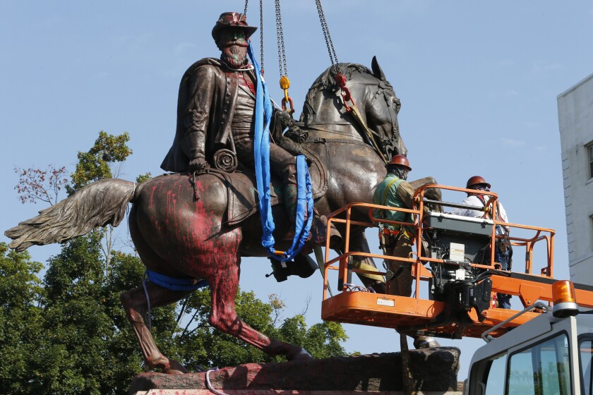 FILE - Crews prepare to remove a statue Confederate General J.E.B. Stuart on Monument Avenue in Richmond, Va. on July 7, 2020. At least 63 Confederate statues, monuments or markers have been removed from public land across the country since George Floyd's death on May 25, making 2020 one of the busiest years yet for removals, according to an Associated Press tally. (AP Photo/Steve Helber, File)