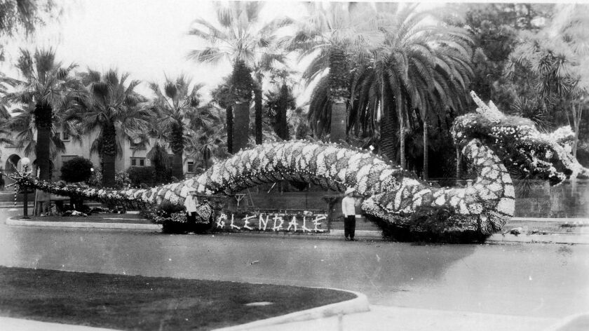 More than forty Elks, garbed in Chinese costumes, escorted the Chinese dragon in Pasadena's 1928