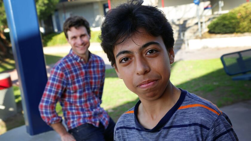 Tamman Abo Nabout (right), a Syrian refugee and Crawford High School student, with singer-songwriter and actor Paul Eddy.