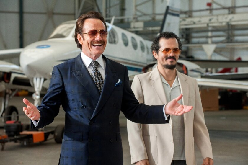 """In this image released by Broad Green Pictures, Bryan Cranston, left, and John Leguizamo appear in a scene from, """"The Infiltrator."""" (Liam Daniel/Broad Green Pictures via AP)"""