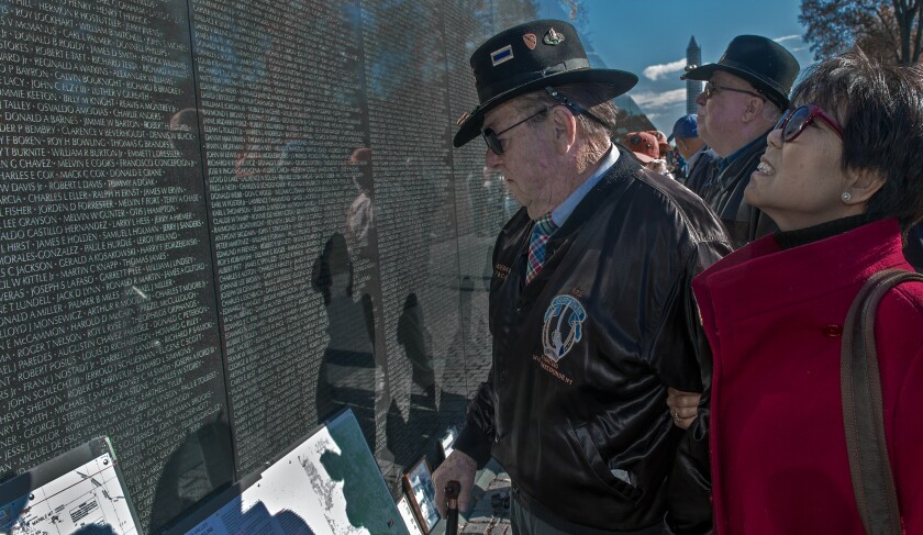 War author and correspondent Joseph Galloway and his wife, Grace, at the Vietnam Veterans Memorial wall in 2013.