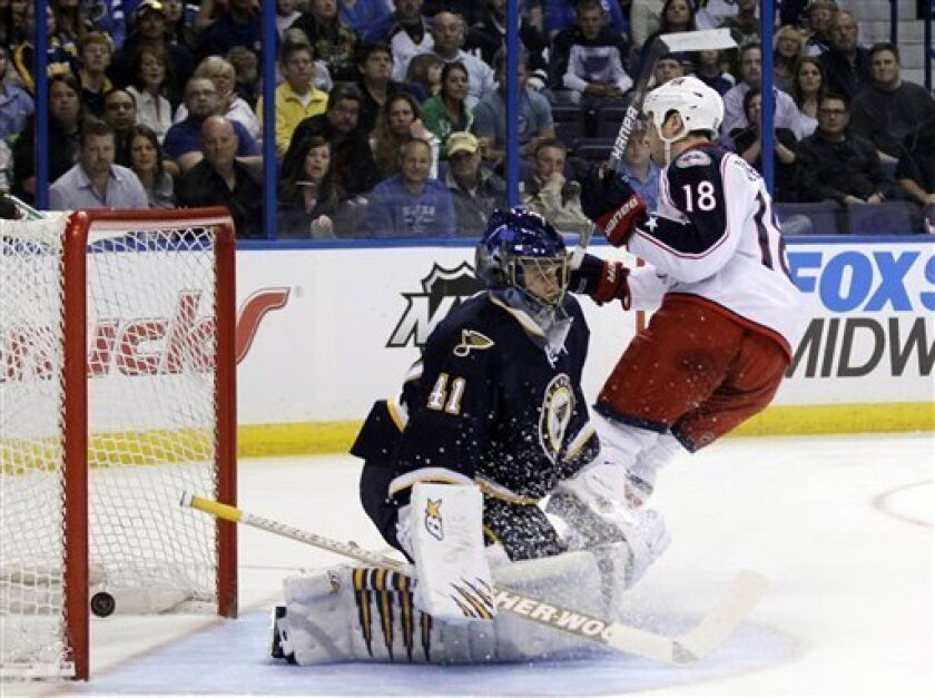 Columbus Blue Jackets' R.J. Umberger (18) scores past St. Louis Blues goalie Jaroslav Halak, of Slovakia, during the first period of an NHL hockey game, Saturday, March 31, 2012, in St. Louis. (AP Photo/Jeff Roberson)