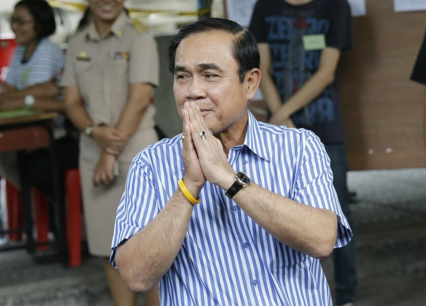 Thailand's Prime Minister Prayuth Chan-ocha leaves after casting his vote in a referendum on a new constitution at a polling station in Bangkok, Thailand, Sunday, Aug. 7, 2016. Thais voted Sunday in a referendum on a new constitution that critics say is tailor-made for the military government to st