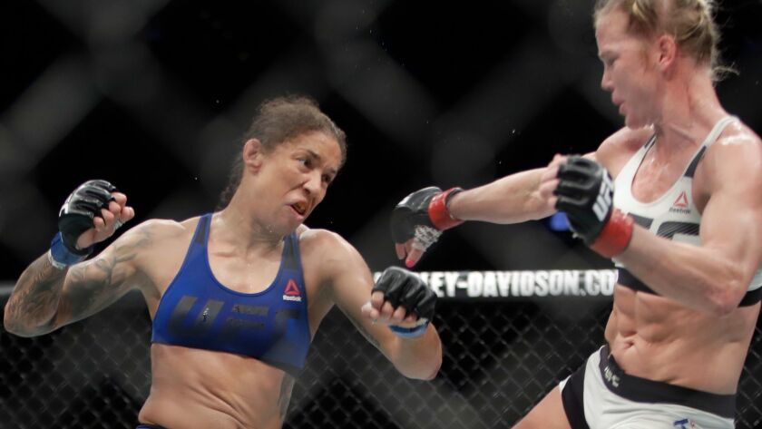 Germaine de Randamie, left, fights Holly Holm during a women's featherweight bout at UFC 208 on Feb. 12.