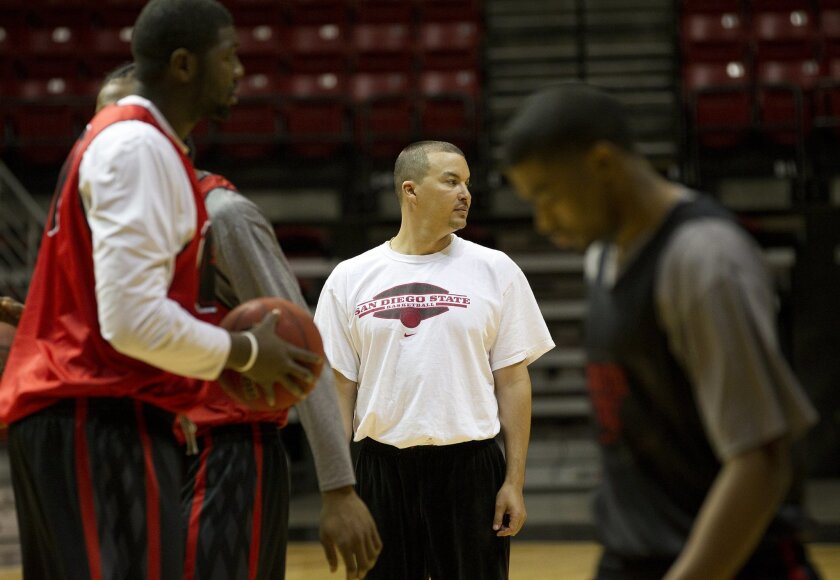 San Diego State's assistant coach Justin Hutson works out his players during basketball practice at Viejas Arena Tuesday.