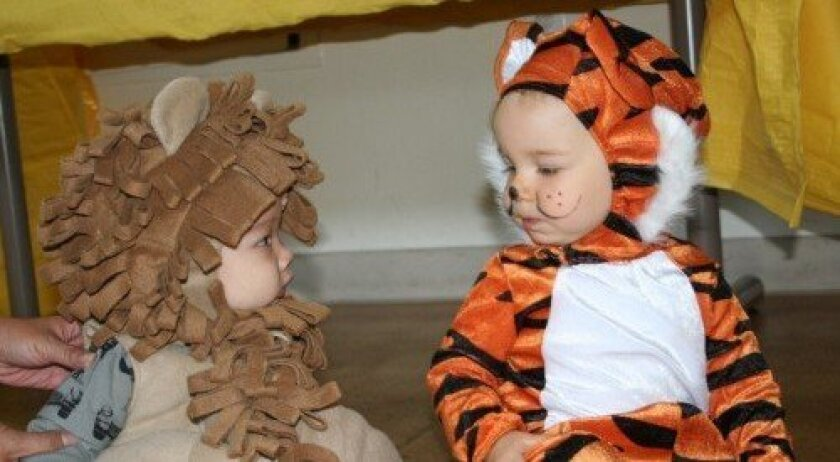 Tots Hudson Hostoft and Colin Haney check out each other's costumes. (Photo: Karen Billing)