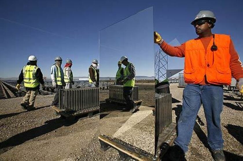 Workers install mirrors at an eSolar demonstration plant in Lancaster. The city hopes the company will provide jobs for Antelope Valley residents.