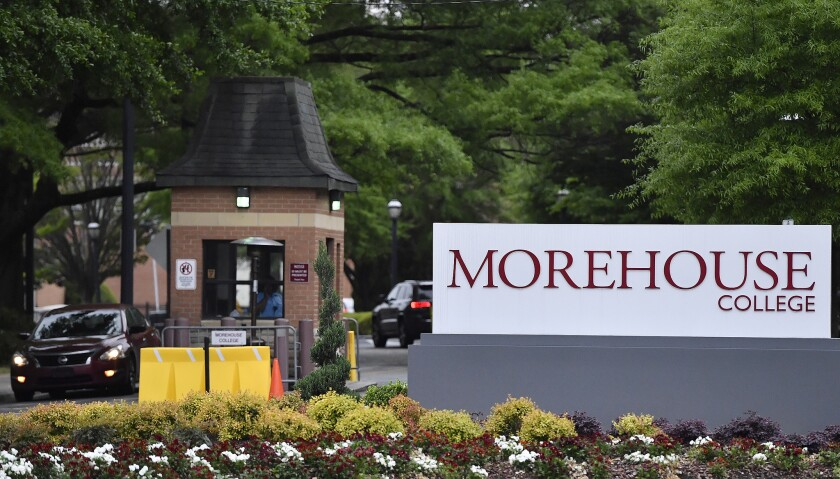 In this Friday, April 12, 2019 photo, people enter the campus of Morehouse College in Atlanta. The c